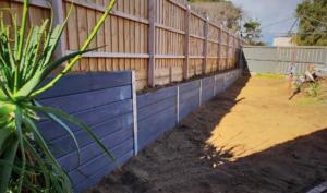retaining wall, hammer excavations, concrete sleeo